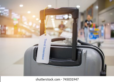 Travel Insurance tag on suitcase holder with tag tied letters enjoyable your trip on bag. Travel Insurance is intended cover medical expenses, cover lost luggage, flight cancellation or accident.