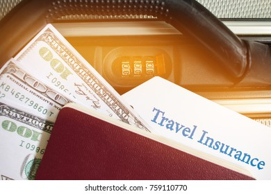 Travel Insurance tag on suitcase near numeric combination lock,passport and US Dollar. Travel Insurance is intended cover medical expenses,cover lost luggage flight cancellation or accident