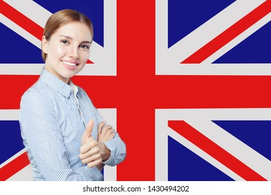 Travel, internship and learn english language in United Kingdom. Pretty girl student with thumb up against the UK flag background