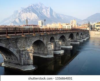 Travel to Italy - bridge Ponte Azzone Visconti (Ponte Vecchio) over river Adda of Como Lake in Lecco city, Lombardy