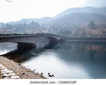 Travel to Italy - bridge Ponte John Fitzgerald Kennedy through Como Lake in Lecco city, Lombardy