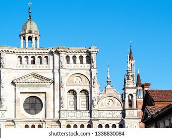 Travel to Italy - facade of church and towers of Certosa di Pavia Gra-Car (Carthusian Monastery, Monastero di Santa Maria delle Grazie, Santuario Gratiarum Carthusia) near Pavia, Lombardy in spring