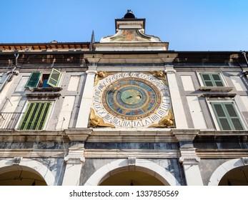 Travel to Italy - facade of medieval Clock Tower Torre dell'Orologio on Piazza della Loggia in Brescia city