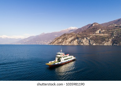 Travel in Italy, ferry boat on lake of Como. Aerial photo