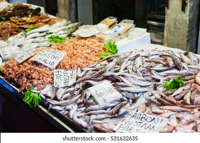 travel to Italy - fish on ice in market in Venice city