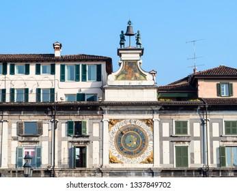 Travel to Italy - front view of Clock Tower Torre dell'Orologio with statues Macc de le Ure (Tone E Batista) on Piazza della Loggia in Brescia city.