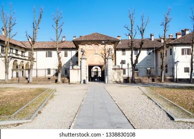 Travel to Italy - front view of entrance to Certosa di Pavia Gra-Car (Carthusian Monastery, Monastero di Santa Maria delle Grazie, Santuario Gratiarum Carthusia) near Pavia city, Lombardy in spring