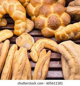 travel to Italy, italian cuisine - fresh baked breads in baker shop in Sicily