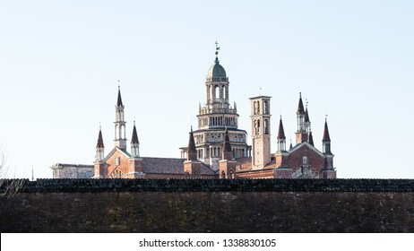 Travel to Italy - panoramic view of Certosa di Pavia Gra-Car (Carthusian Monastery, Monastero di Santa Maria delle Grazie, Santuario Gratiarum Carthusia) over fence near Pavia city, Lombardy
