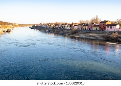 Travel to Italy - residential houses on street Via Milazzo along Ticino river bank in Pavia city, Lombardy in spring