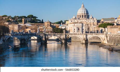 Travel to Italy - Rome cityscape with St Peter Basilica and Tiber River in sunny winter day