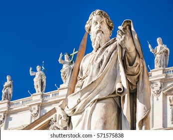 Travel to Italy - Sculpture of Apostle Paul near St Peter Basilica in Vatican city in sunny winter day. The statue of St Paul was sculpted in 1838 by Adamo Tadolini