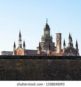 Travel to Italy - view of Certosa di Pavia Gra-Car (Carthusian Monastery, Monastero di Santa Maria delle Grazie, Santuario Gratiarum Carthusia) with stone fence near Pavia city, Lombardy