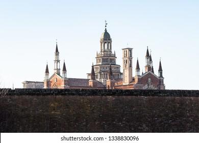 Travel to Italy - view of Certosa di Pavia Gra-Car (Carthusian Monastery, Monastero di Santa Maria delle Grazie, Santuario Gratiarum Carthusia) with outer walls near Pavia city, Lombardy