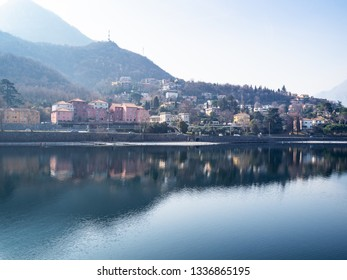 Travel to Italy - view of houses on street via Giuseppe Parini along Lario Como lake in Lecco city, Lombardy in spring haze