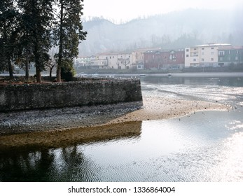 Travel to Italy - view of island Isola Viscontea in river Adda of Como Lake in Lecco city from waterfront on street via dell Isola, Lombardy