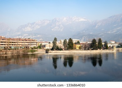 Travel to Italy - view of island Isola Viscontea near waterfront of river Adda of Como Lake in Lecco city, Lombardy