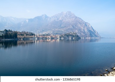 Travel to Italy - view of Lario Como lake and mount Moregallo and Lecco city, Lombardy in spring haze