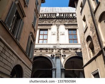 Travel to Italy - view of medieval Palazzo Loggia (seat of the municipal council of Brescia) on Piazza della Loggia through street in Brescia city, Lombardy