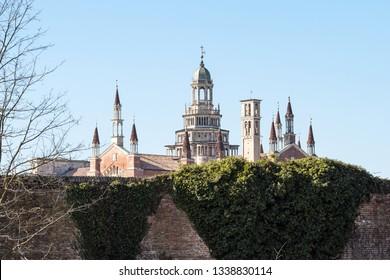 Travel to Italy - view of towers of Certosa di Pavia Gra-Car (Carthusian Monastery, Monastero di Santa Maria delle Grazie, Santuario Gratiarum Carthusia) near Pavia city, Lombardy in spring