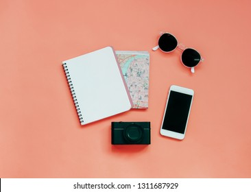 Travel items concept : blank notebook, map, camera, smartphone and sunglasses, top view with minimal style