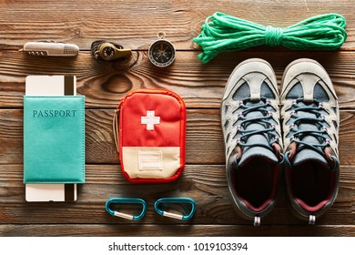 Travel items for hiking tourism flat lay still life over wooden background