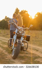 Travel and love, passion, bike road. Couple in love on the road with a motorcycle. Boy and girl in love.