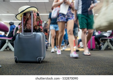 travel luggage with passenger blur background