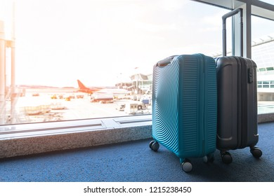 Travel luggage suitcase at the airport terminal in waiting area for departure flight for business transportation and vacation journey concept