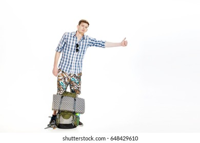 Travel man hitchhiking. young male hitchhiker on white background