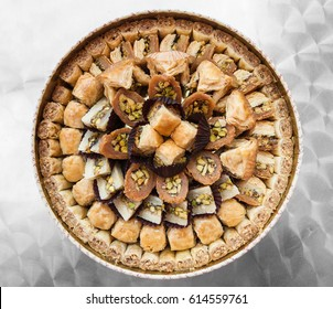 Travel to Middle East country Kingdom of Jordan - top view of many traditional arabian sweet pastry baklava