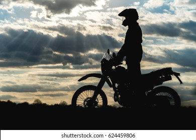 travel motorcycle off road Silhouette of a motorcyclist against the sky cloud
