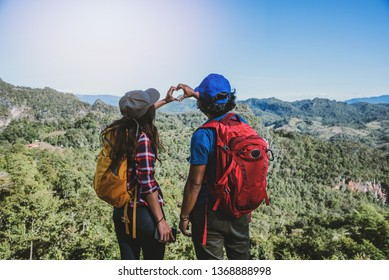 Travel, nature travel of Asian couples while is relaxing outdoors during his trip in Thailand.