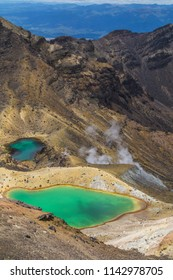 Travel New Zealand. Beautiful scenic panorama view of the green lakes on tourist most popular day hike Tongariro Alpine Crossing. Volcanic landscape. Tongariro National Park, North Island