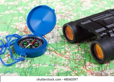 Travel north map direction compass and binoculars