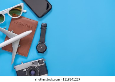 Travel objects for backpacker on blue copy space