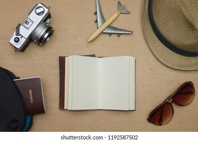 Travel objects flat lay on wooden table, Vacation concept