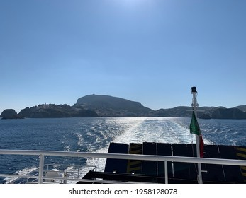 Travel on ferry from island with sun