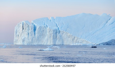 Travel on a research vessel among polar icebergs. Studying of a phenomenon of global warming. Catastrophic thawing of ices of polar regions.