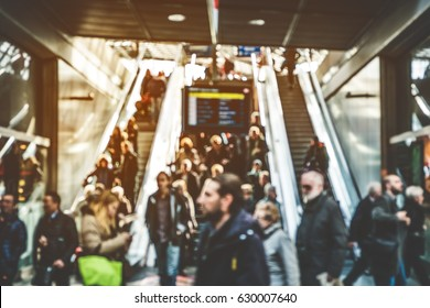 travel people on escalator - concept blur of people on stairs