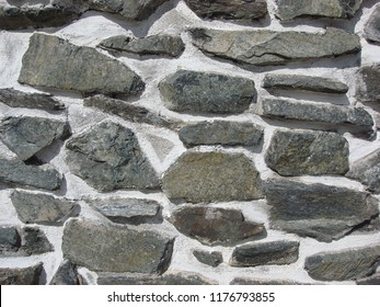 Travel photo from Arges County, Romania. Close up of stone wall.