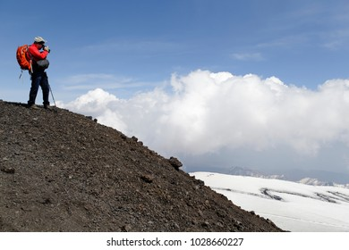 Travel photografer over the clouds. Panoramic view from Etna mountain. Sicily, Italy.