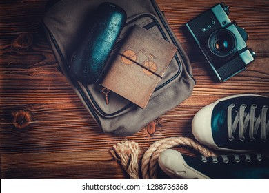 travel photographer accessories on wood background. vacation concept