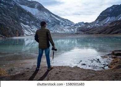 Travel photographer enjoying the milk lake view of Yading Park in the iceberg area.