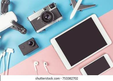 Travel Photographer gadgets and accessories object flat lay Top view on blue and pink background for travel concept with Blank Tablet and Mobile phone screen for Application mock up