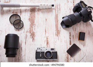 Travel photography background with cameras, monopod, filters and bateries