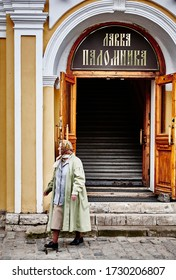 Travel photography of the exterior of Lavka Palominka, a shop in Sergiev Posad and an elderly lady, Golden Ring Russia