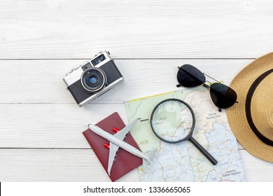 Travel Plan. Traveler planning trips summer vacations with Traveler's accessories, retro camera, sunglass and passport in summertime. Top view and copy space for banner