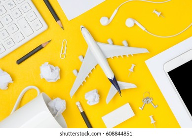 Travel Planning. Airplane, smart phone, pencil, paper note, paper clip, earphone, calculator with blank space. Preparation for Traveling and Flat lay Concept.