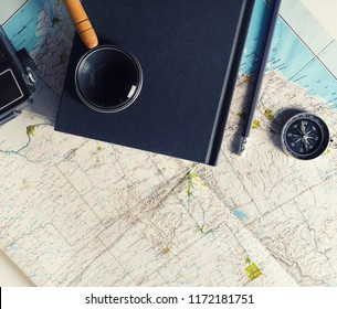Travel planning concept. Vintage toned image. Flat lay
